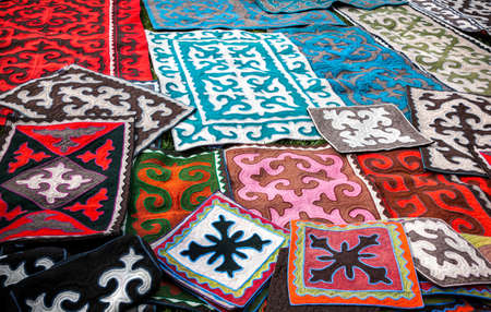 Ethnic oriental carpets with national patterns at Asian market photo