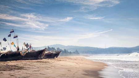 india fisherman: Fisherman boats on the Gokarna beach near the ocean in Karnataka, India