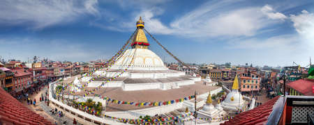 buddhist stupa: BODNATH, KATHMANDU, NEPAL - APRIL 6, 2014: Panorama of Bodnath stupa from the roof top restaurant. Most popular center of Buddhism pilgrimage in Nepal