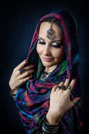 gipsy: Portrait of beautiful woman with Indian tikka wrapped in scarf