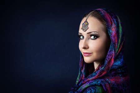 bollywood woman: Portrait of beautiful woman with Indian tikka wrapped in scarf