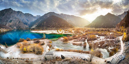 tyan shan: Issyk mountain lake panorama at sunset sky in Kazakhstan