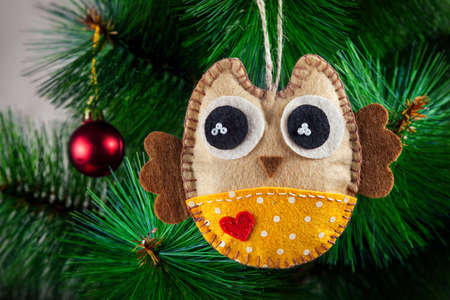 Handmade owl with big eyes from felt on Christmas tree photo
