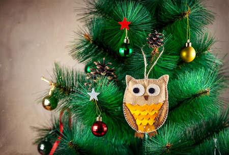 Handmade owl with big eyes from felt on Christmas tree photo
