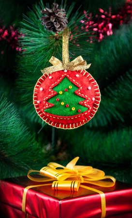Felt handmade ball on the Christmas tree photo