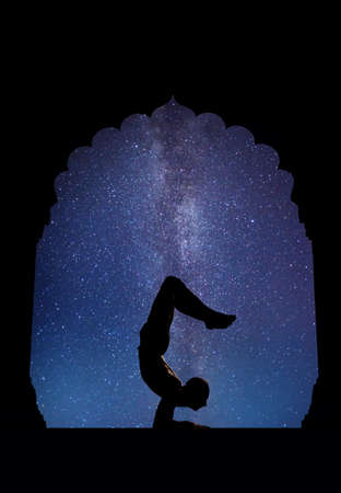 Yoga in old temple at night sky with Milky Way and stars photo