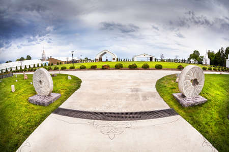 issyk kul: Ruh Ordo cultural complex near Issyk Kul lake at overcast sky in Cholpon Ata, Kyrgyzstan
