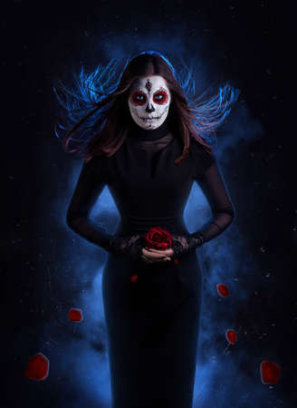 corpse flower: Woman in black dress with sugar skull makeup holding red rose with falling petals at dark background Stock Photo