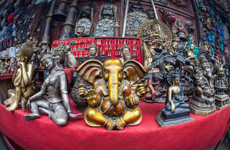 Souvenir statues of Ganesh, Buddha and other goddess in the shop of Kathmandu, Nepal