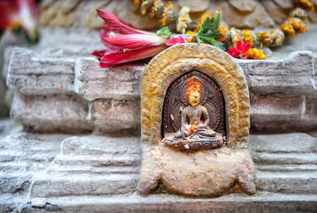 pooja: Buddha statue with yellow color tikka in Patan, Nepal