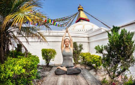 bodnath: Woman doing yoga meditation near Bodnath stupa, Kathmandu, Nepal