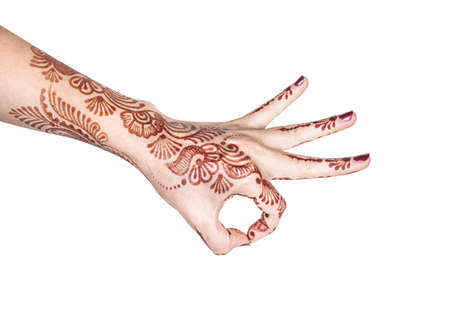 yogic: Woman hand with henna doing Dhyana mudra isolated on white background with clipping path