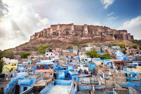Blue city and Mehrangarh fort on the hill at sunset sky in Jodhpur, Rajasthan, India