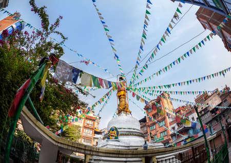 tibetan house: Tahiti Tole Buddhist stupa with prayer flags at blue sky in Thamel, Kathmandu, Nepal