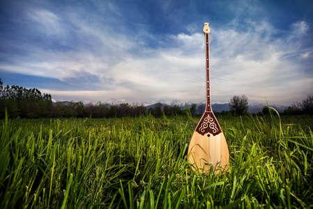 kazakh: Dombra Kazakh instrument in the grass at blue sky