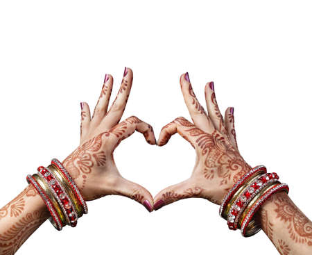 mehndi: Woman hands with henna doing heart gesture isolated on white background with clipping path Stock Photo