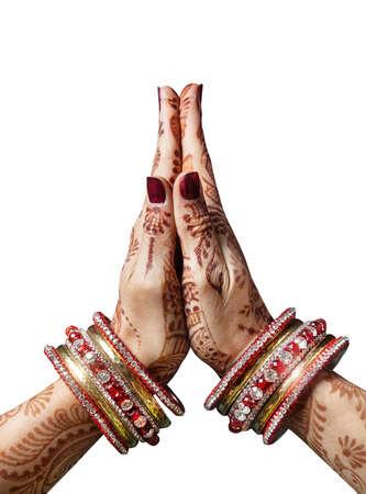 Woman hands with henna in Namaste mudra on white background Standard-Bild
