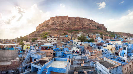 hill of the king: Blue city and Mehrangarh fort on the hill at sunset sky in Jodhpur, Rajasthan, India