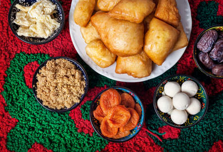 kazakh: Kazakh national dishes on the carpet with ornament in restaurant Stock Photo
