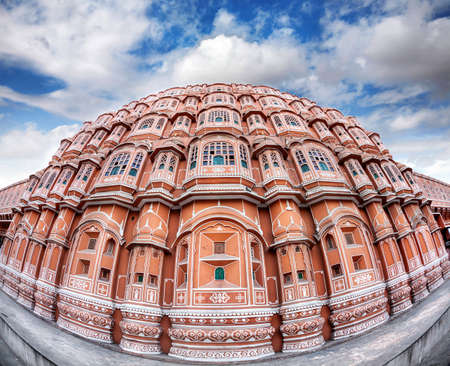 rajput: Hawa Mahal facade with many windows and balconies at blue sky in Jaipur Rajasthan, India