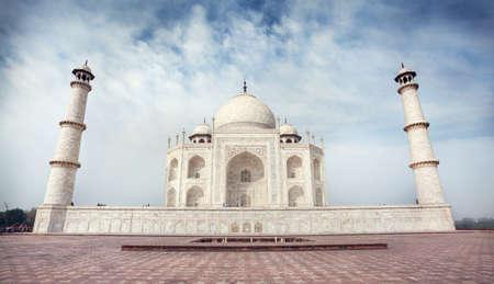 uttar: Taj Mahal tomb from white marble at blue sky in Agra, Uttar Pradesh, India