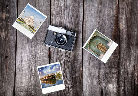 photo camera: Old film camera and   photos with Indian famous landmarks on the wooden background Stock Photo