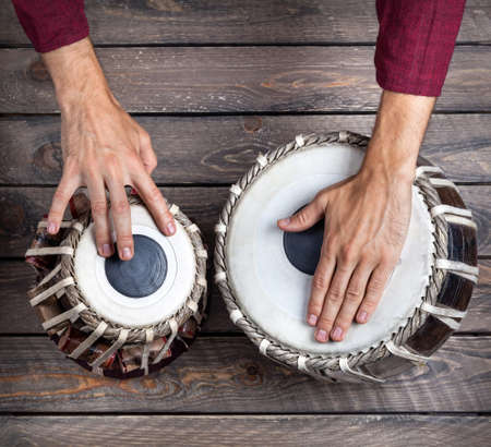 red indian: Man playing on traditional Indian tabla drums close up Stock Photo