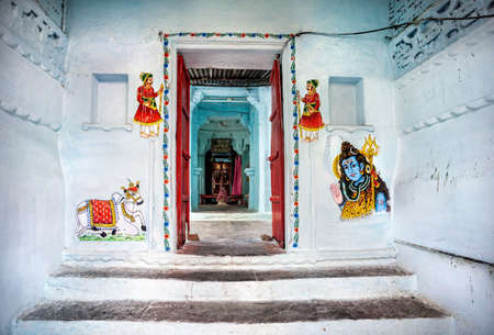 Traditional Rajasthan paintings on the Hindu temple wall in Udaipur, Rajasthan, India