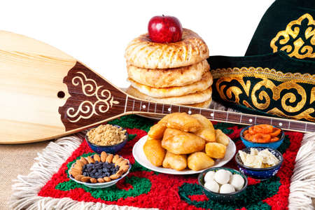 kazakh: Asian dishes and Dombra Kazakh instrument on the ethnic carpet in yurta