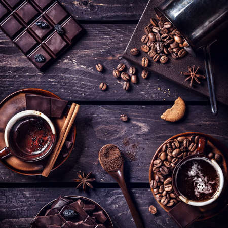 Coffee and dark chocolate with spices on the dark wooden table Stock Photo