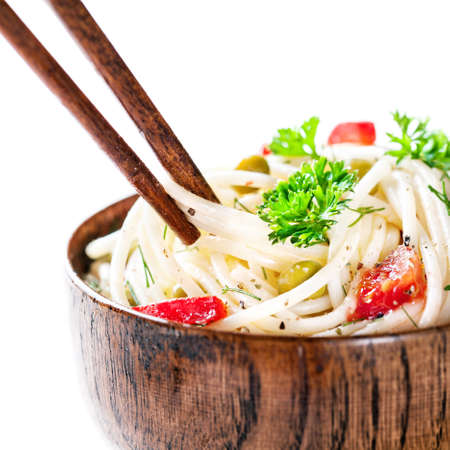 china cuisine: Chopsticks with Vegetarian noodles on white background Stock Photo