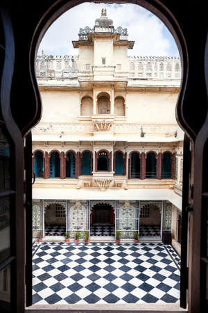 rajasthani painting: City Palace museum with surreal chess floor in Udaipur, Rajasthan, India Stock Photo