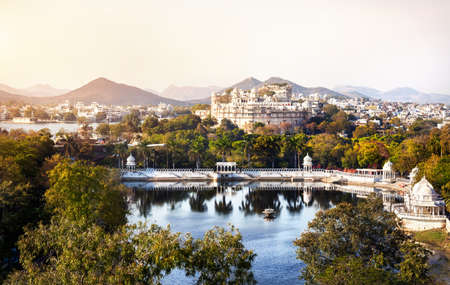 king palace: Lake Pichola with City Palace view in Udaipur, Rajasthan, India Editorial