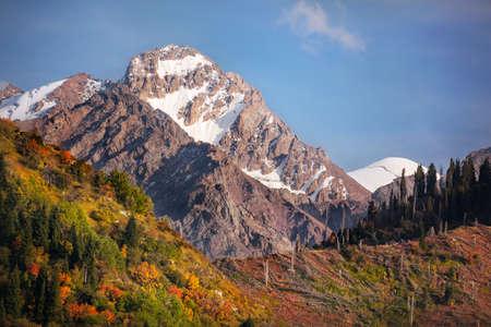 tyan shan: Komsomol peak view at blue sky in autumn season in Kazakhstan Stock Photo