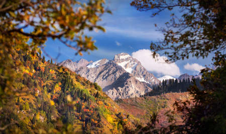 tyan shan mountains: Komsomol peak view at blue sky in autumn season in Kazakhstan Stock Photo