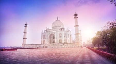 uttar: Taj Mahal tomb in the purple foggy morning in Agra, Uttar Pradesh, India