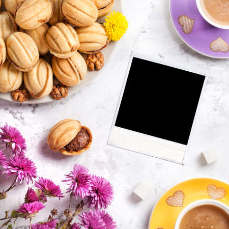 sweet dreams: Picture frame around coffee and sweet homemade nuts on white marble background