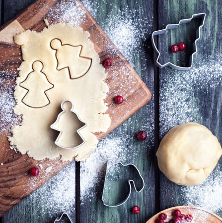 christmas cooking: Christmas angels cookies from dough in cooking backstage process on wooden table background