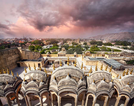 balcony design: View to Old Jaipur city sight from the roof of Hawa Mahal Palace at purple overcast cloudy sky in Rajasthan, India
