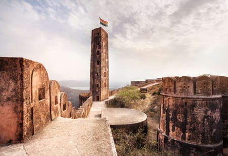 indian culture: Jaigarh fort tower and hogh wall on the hill at overcast sky in Jaipur, Rajasthan, India