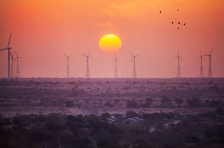Windmills of Thar desert at sunset in Jaisalmer, Rajasthan, India