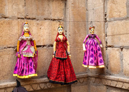 queen's theatre: Colorful Rajasthan puppets hanging in the shop of Jaisalmer City Palace, India