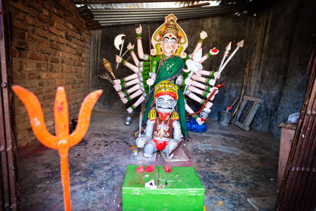 parvati: Goddess statue with many hands in the small temple in Maharashtra, India