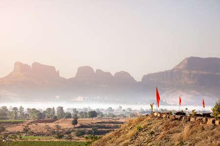 siluet: Foggy mountain valley at sunrise in the village in Nasik, Maharashtra, India