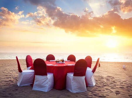 romantic beach: Beautiful romantic red wedding Table on tropical beach at sunset Stock Photo