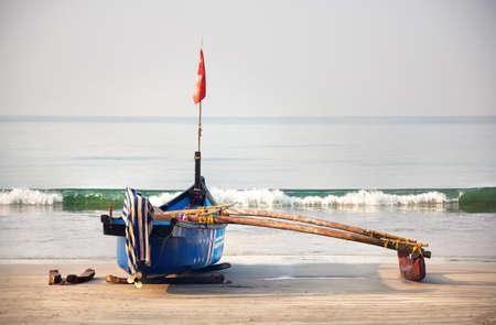 india fisherman: Fisherman boat on the tropical beach at Palolem beach in Goa, India
