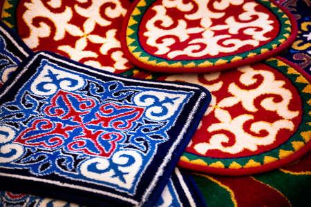 issyk kul: Ethnic oriental carpet with pattern in yurt at Asian market Stock Photo