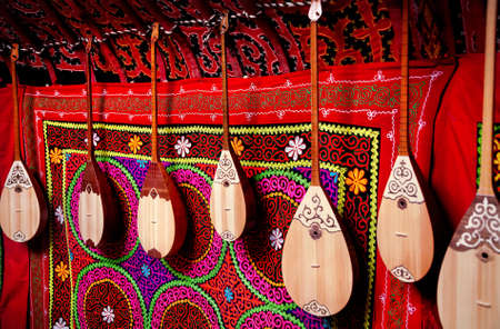 kazakh: Dombra string instruments on the wall of Kazakh yurt at Nauryz celebration in Almaty, Kazakhstan