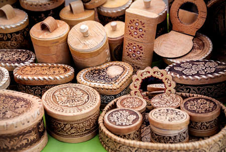 souvenir: Ethnic wooden carved utensil and souvenirs in the market at Nauryz celebration in Almaty, Kazakhstan Stock Photo
