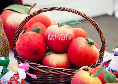 fruit market: Red apple from felt with text Almaty city at the market in Kazakhstan Stock Photo